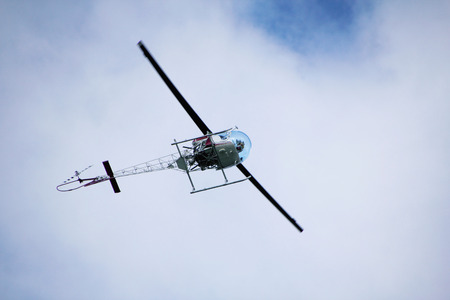 underbelly: Underbelly of a helicopter as it approaches the airport.