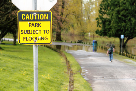 stating: A sign stating that the park is subject to flooding.