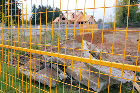 perimeter: Fencing is erected around the perimeter of a construction site to ensure safety.