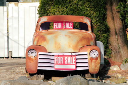 A classic American car, still needing to be restored, is for sale. Stock Photo