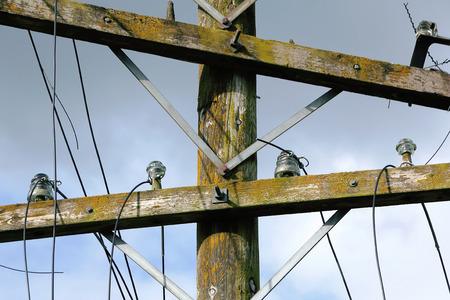 telephone pole: on damaged wires on telephone pole