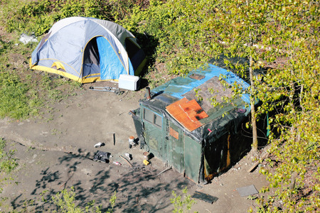 A high angle view of two shelters erected or created by homeless people.