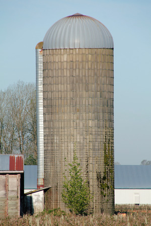 A single, isolated Stave Silo used for storing grain