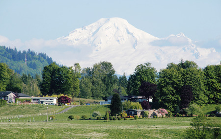 mount baker: Mount Baker towering over a farming community.