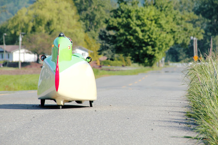 streamlined: Rear View of a velomobile or bicycle car on a rural road