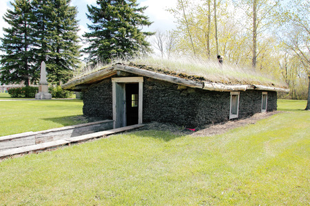 sod: A sod or turf roof is a traditional Scandinavian green roof covered with sod on layers of birch bark on wooden roof boards. Stock Photo