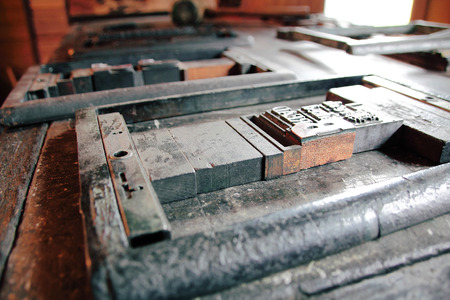 cast metal type: Historic typesetting equipment including frames type and fonts. Stock Photo