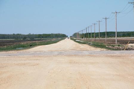 winnipeg: Straight and gravel a prairie road near Winnipeg Manitoba Canada.