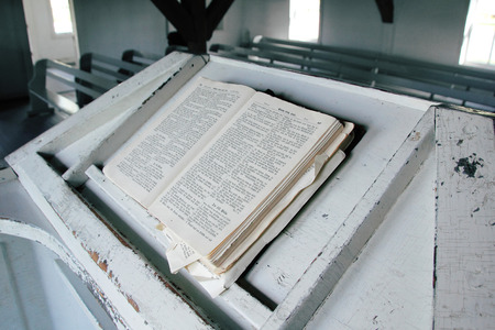 scriptures: German scriptures from the 1800s sits on a pulpit in a rural church. Stock Photo