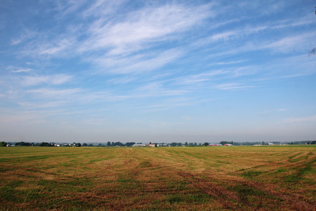 wide open: Wide open prairie and acres of harvested grassland. Stock Photo