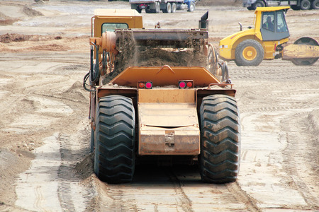 construction machinery: Large construction machinery used for preparing a construction site.