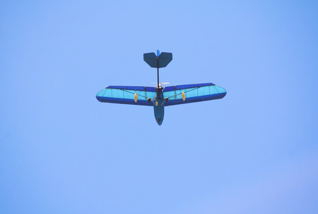 reverse: A plane flies overhead with the engine and propeller mounted on the back.