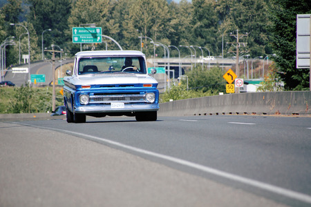 fraser river: A vintage truck is on its way to the Fraser River Heritage Park in Mission BC for the annual antique car display on June 21 2015.