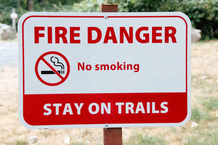 warns: A public sign warns that smoking is forbidden on a nature trail
