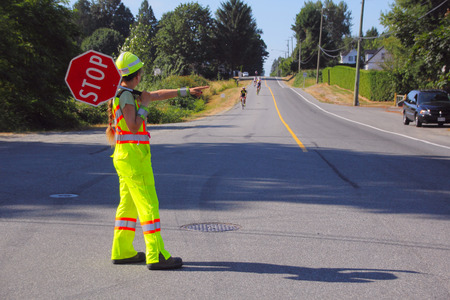 traffic controller: Cyclists are directed by a traffic controller during the Prospera Valley Gran Fondo cycling race on July 19, 2015.