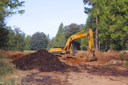 An industrial shovel is used to clear and prepare land for residential construction.