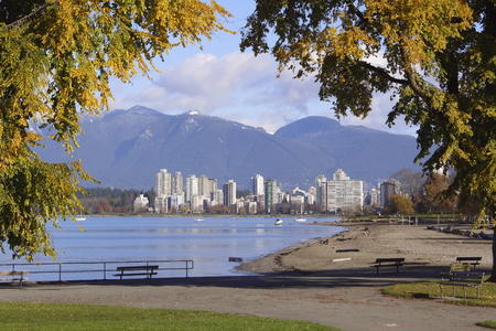 Standing in Kitsilano looking across English Bay to the city of Vancouver, Canada. Stock Photo
