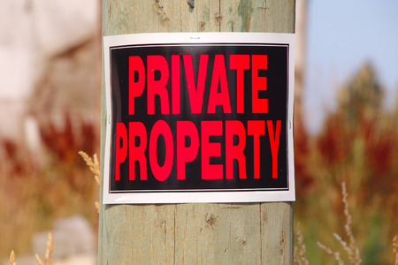 property: A sign clearly states that the property is private. Stock Photo