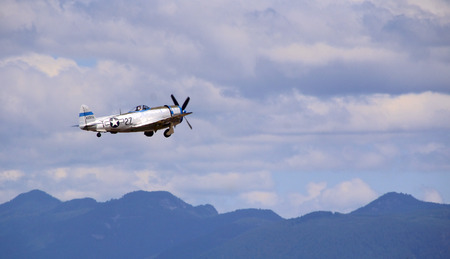 restored: A restored American Republic P-47D Thunderbolt flying from left to right.
