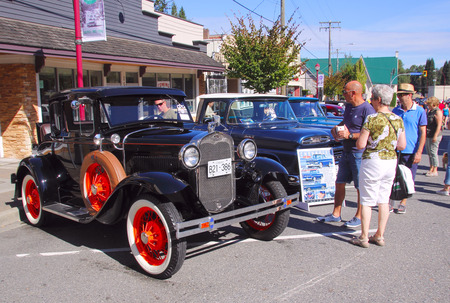 restored: People admire restored vintage automobiles at the Abbotsford Car show on August 22, 2015. Editorial