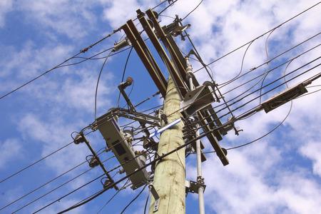 A complicated arrangement of electrical distribution lines on a pole. Reklamní fotografie