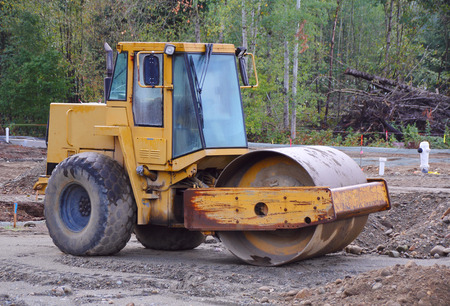 steamroller: A mid-sized steamroller used for leveling ground on a construction site.
