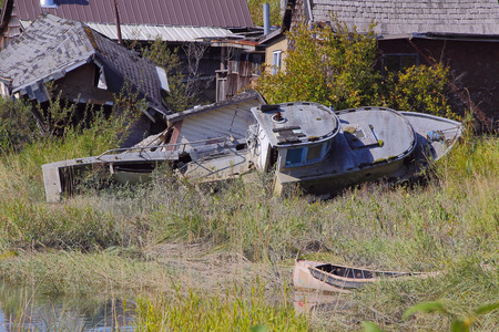 thriving: A derelict boat in Finn Slough is a reminder of the once thriving fishing industry in Richmond, BC. Stock Photo