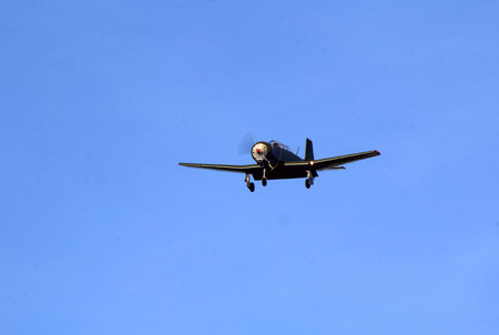 wwii: A WWII single engine fighter plane approaching the runway.