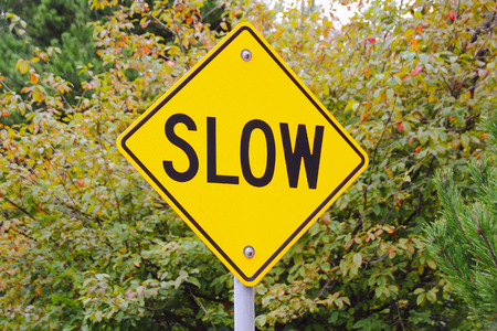alerts: A bright yellow sign alerts motorists to slow down.