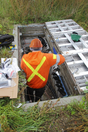 hydro electric: View of an electrician preparing a new underground hydro electric distribution line. Stock Photo