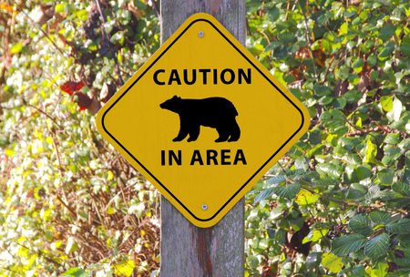 signage outdoor: A sign warns people that there are bears in the area Stock Photo