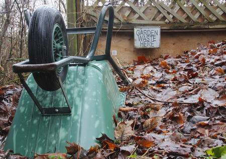 wheel barrel: Wheel Barrel, Sign and compost pile where garden waste is recycled.