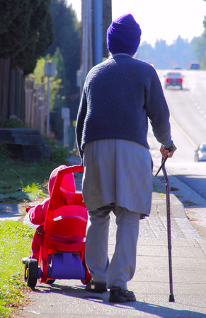 indo: An Indo Canadian grandfather walks with his grandson. Stock Photo