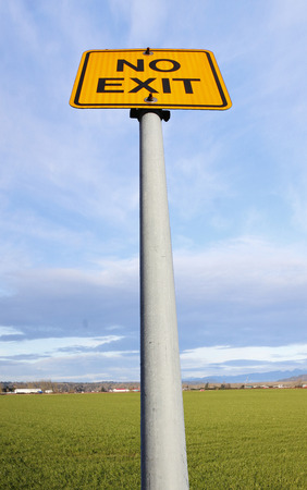 low angle view: A low angle view of a no exit sign on a pole.