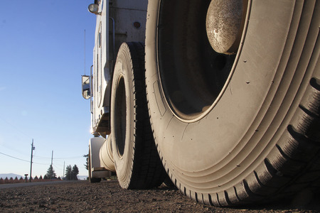 A low angle view of truck or semi trailer tires.