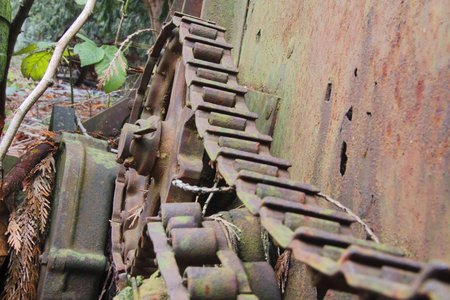 Close on a rusting chain and housing wheel on old farm equipment. Stock Photo