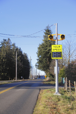 permanent: Vertical view of a permanent electronic sign displaying the speed drivers are currently going.