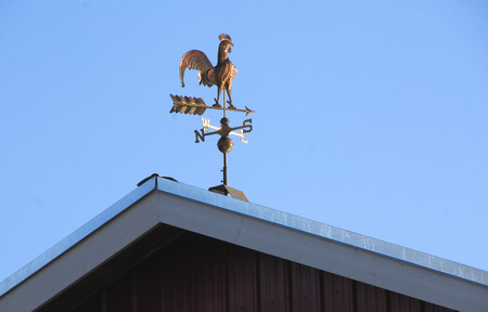 A weather vane indicates the wind direction blowing northwest.