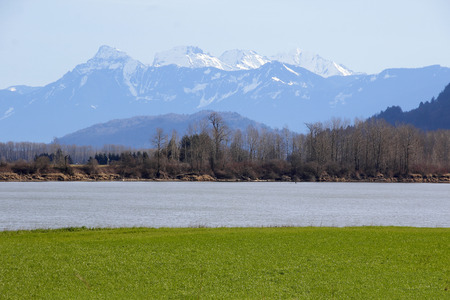 fraser river: The Fraser River in southwest British Columbia flows under the Sumas Mountain range.