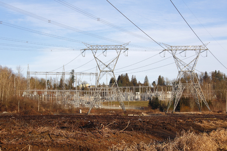 Electricity is delivered and routed through a major hub or sub station. Stock Photo