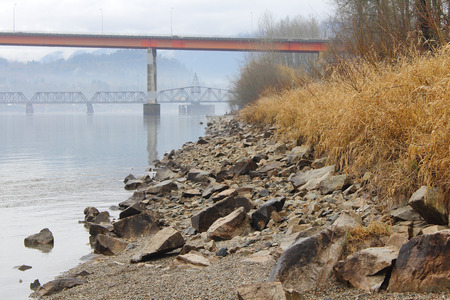 enforce: Small rocks are used to enforce the riverbank and prevent erosion during heavy rains. Stock Photo