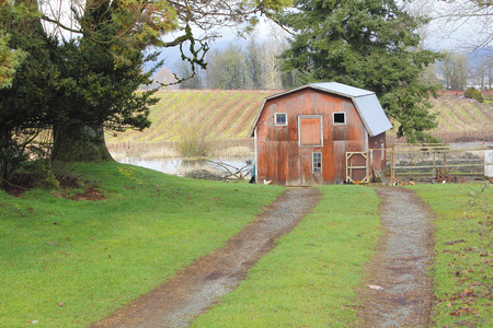 modest: A small, modest barn is found at the end of a dirt road.
