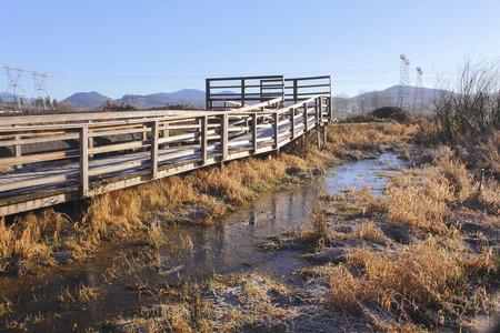 suspend: A nature path constructed above marshland provides a non-destructive trail through a fragile ecosystem.