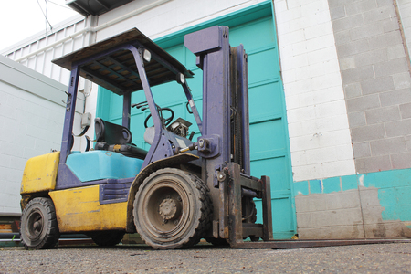 outside machines: A small industrial forklift used for heavy lifting.
