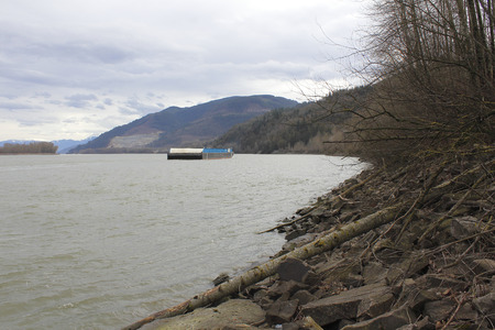 canadian pacific: A river barge is transported down the Fraser River on Canadas west coast.