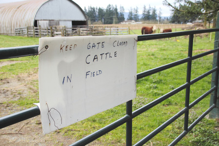 penned: A sign asks visitors to keep the farm gate closed.