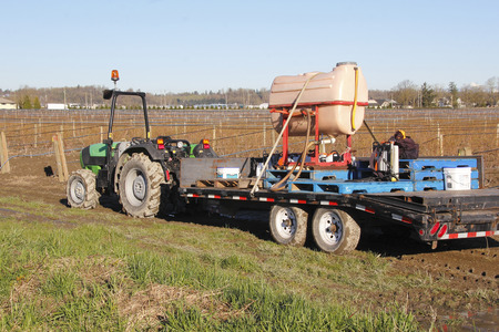 outside machines: Farm equipment used for spraying chemicals and fertilizers on crops.