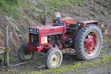 outside machines: An old, weather-worn tractor from the 1960s.