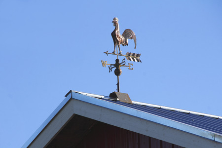 wind vane: A weather vane indicates which direction the wind is blowing. Stock Photo