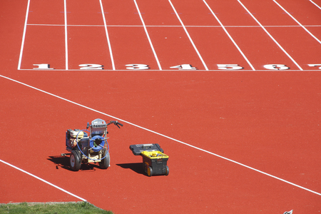 specifically: Equipment used specifically for marking lanes on an athletic track. Stock Photo